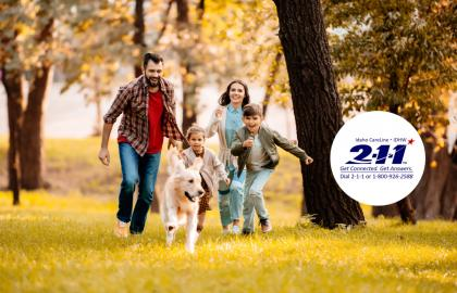 Image of logo with family and dog running in a woody area.